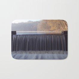 misty sunrise waterfall Bath Mat