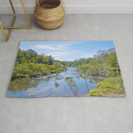 Beautiful tranquil river in the tropics Rug