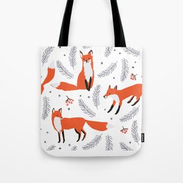 Red foxes and berries in the winter forest Tote Bag