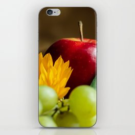 An autumn gifts still life on the blurred background iPhone Skin