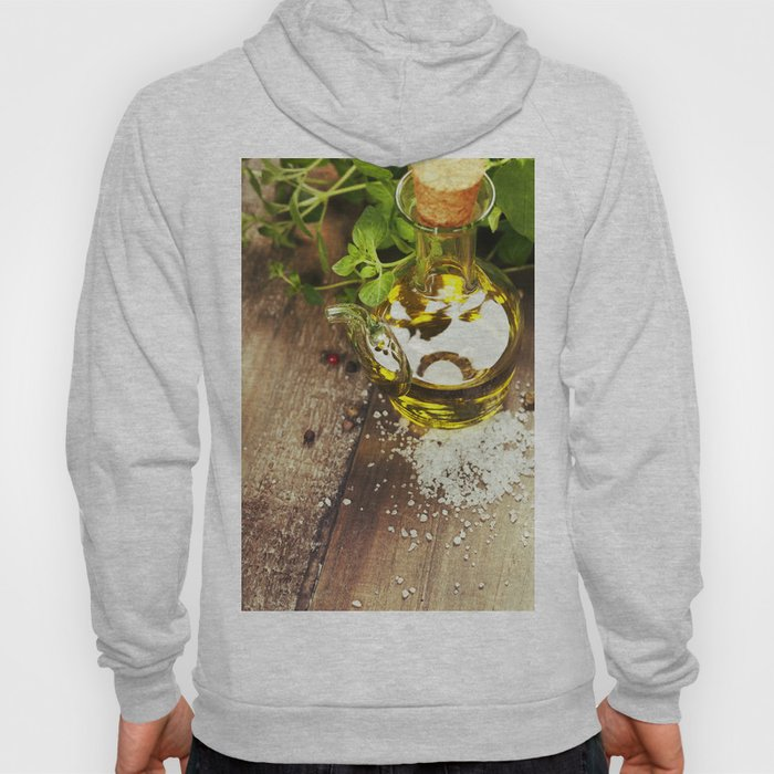 Olive oil,  herbs and spices on a wooden table Hoody