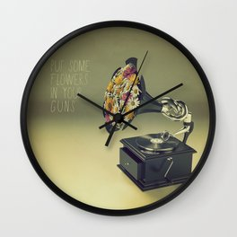put some flowers in your guns Wall Clock