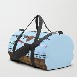 Hanging laundry in blowing wind Duffle Bag