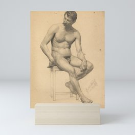 Seated male nude, looking to the left by Gustav Klimt Mini Art Print