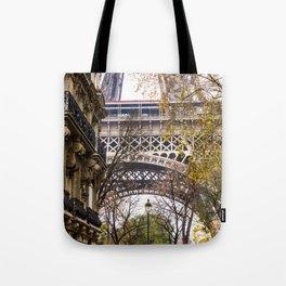 Eiffel Tower in Between Buildings Tote Bag