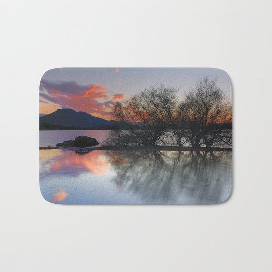 Trees in the water at the red sunset Bath Mat