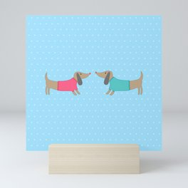 Cute dogs in love with dots in blue background Mini Art Print