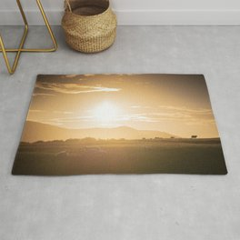 Sheep grazing in Lake District at sunset in England Rug