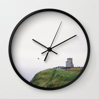 ruben ireland Wall Clocks featuring Ireland by Sophie Pellegrini