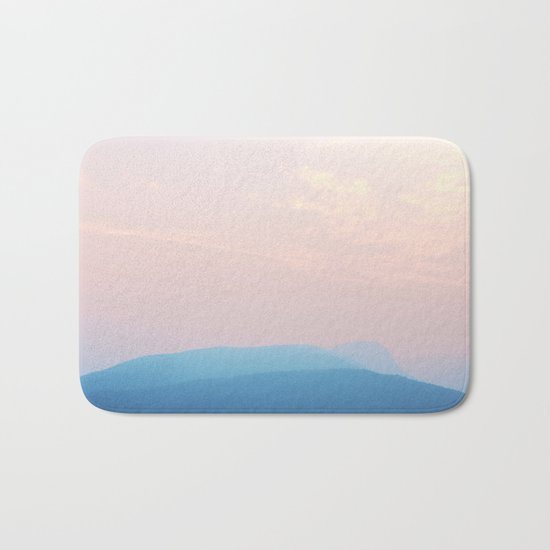 Pastel sunset over the mountains Bath Mat