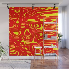 Red spreading spots of color on yellow. Wall Mural