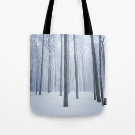 Foggy frozen winter forest Tote Bag