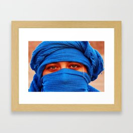 A portrait of a blue eyes lady with a blue desert scarf around her head in Egypt Framed Art Print