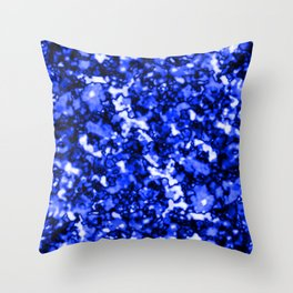 A bright cluster of blue bodies on a dark background. Throw Pillow