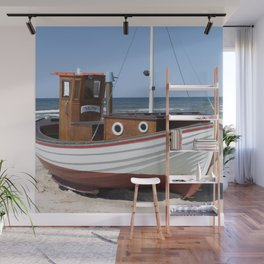 Wooden fishing boat on the beach. Wall Mural