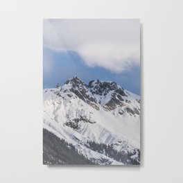 Clouds roll over the snow covered mountains of Innsbruck in Austria. Metal Print