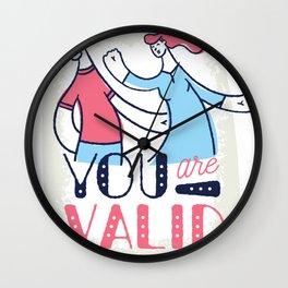 Proud woman with man saying Wall Clock