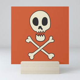 Skull & Crossbones on orange Mini Art Print