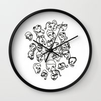 talking heads Wall Clocks featuring Talking Heads by Melanie Carter