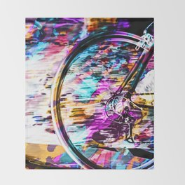 bicycle wheel with colorful abstract background in pink blue orange Throw Blanket