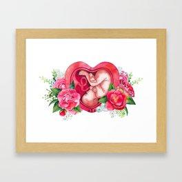 Watercolor fetus inside the womb Framed Art Print
