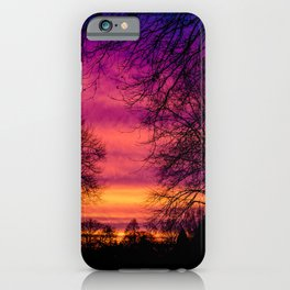 Purple, pink, orange sunrise with silhouette trees iPhone Case