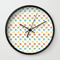 planes Wall Clocks featuring Colored planes by Yasmina Baggili