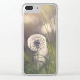 Dandelion blossom defocused in garden Clear iPhone Case