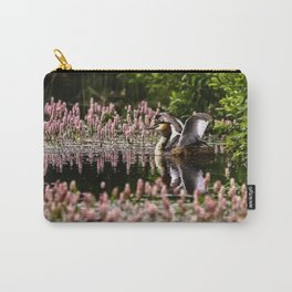 Grede stretching wings on pond, with flowering weed. Carry-All Pouch