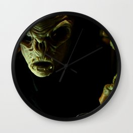 Alien in Darkness Wall Clock