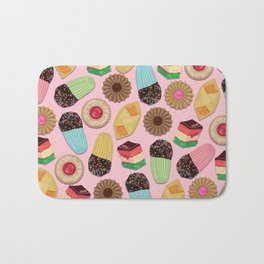 Assorted Cookies on Pink Background Bath Mat