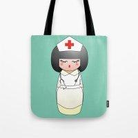 nurse Tote Bags featuring Kokeshi Nurse by Pendientera