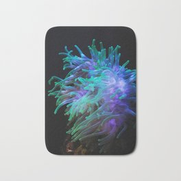 Sea anemone on a black background Bath Mat