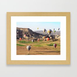 Hot air balloons flying over Cappadocia Framed Art Print