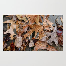 leaves in the rain Rug