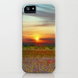Red poppies and bluebells amid the setting sun iPhone Case