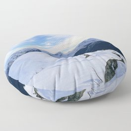 The snowy rocks at mountain tops Floor Pillow