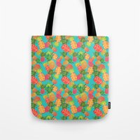 pineapples Tote Bags featuring Pineapples by Laura Barnes