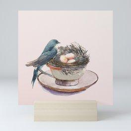 Bird nest in a teacup Mini Art Print