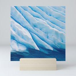 Blue Ice Iceberg Slipping Into Ocean Waters Mini Art Print