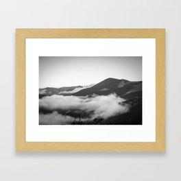 Clouds hanging on  Framed Art Print