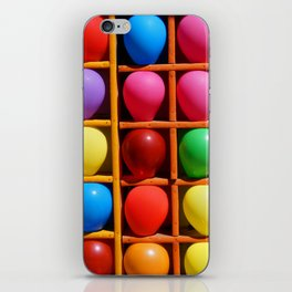 colorful balloons in wooden boxes, attraction iPhone Skin