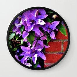 Beautiful purple flowerbush on the wall Wall Clock
