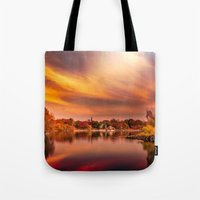jamaica Tote Bags featuring Sunset over Jamaica Pond by LudaNayvelt