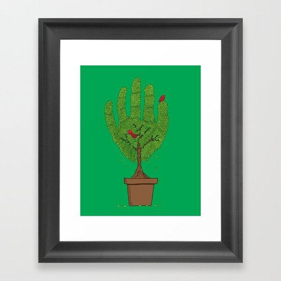 A bird in hand Framed Art Print