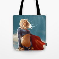 supergirl Tote Bags featuring Supergirl by abraaolucas