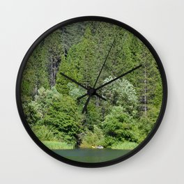 one kayak in the green Wall Clock