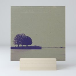 A textured potograph of the trees at the end of the pier Mini Art Print