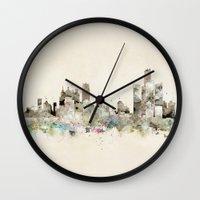 michigan Wall Clocks featuring Detroit Michigan skyline by bri.buckley