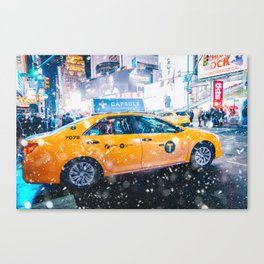 People in yellow cab shot famous led advertising panels in Times Square during snow Canvas Print